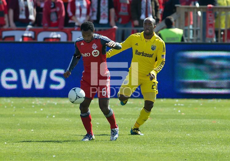 31 March 2011: Toronto FC midfielder Julian de Guzman #6 and Columbus Crew forward Emilio Renteria #20 in action during a game between the Columbus Crew and the Toronto FC at BMO Field in Toronto, Ontario Canada.