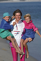 Bruce Jenner carrying sons Brody (left) and Brandon, Malibu California, September, 1988. Photo by John G. Zimmerman