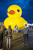 CANADA, Vancouver, British Columbia, people pose for pictures in front of a huge yellow duckl at the Asian Night Market at Magical Duck Island in Richmond