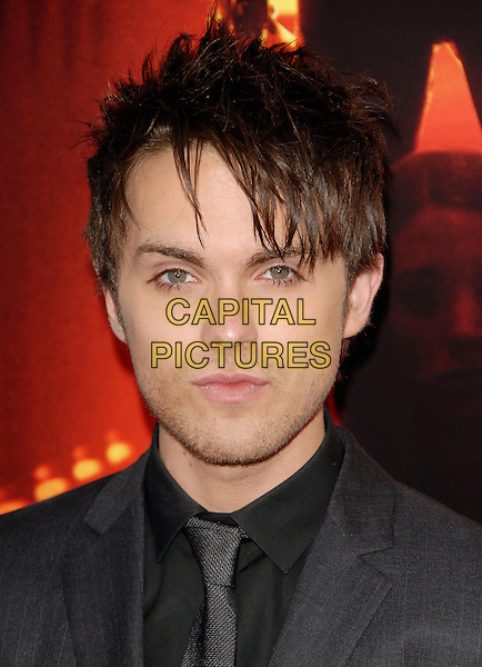 """THOMAS DEKKER.The Warner Bros. Pictures World Premiere of """"A Nightmare on Elm St."""" held at The Grauman's Chinese Theatre in Hollywood, California, USA..April 27th, 2010.headshot portrait black grey gray stubble facial hair.CAP/RKE/DVS.©DVS/RockinExposures/Capital Pictures."""