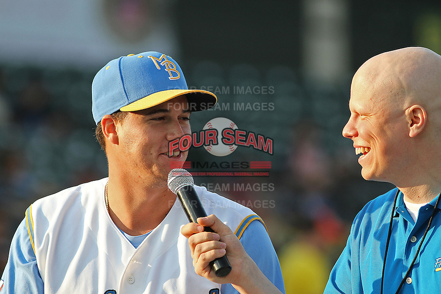 "Myrtle Beach Pelicans pitcher Alex ""Chi-Chi""Gonzalez #23 being interviewed by Pelicans radio broadcaster Nathan Barnett before a game against the Salem Red Sox at Ticketreturn.com Field at Pelicans Ballpark on April 3, 2014 in Myrtle Beach, South Carolina. Salem defeated Myrtle Beach 10-2. (Robert Gurganus/Four Seam Images)"