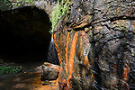Just a trickle over colorful rock near a small cave opening in Raccoon State Park outside of Pittsburgh.