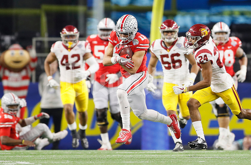 Ohio State Buckeyes wide receiver Austin Mack (11) catches a pass in front of USC Trojans cornerback Isaiah Langley (24) during the first quarter of the Goodyear Cotton Bowl Classic at AT&T Stadium in Arlington, Texas on Dec. 29, 2017. [Adam Cairns / Dispatch]