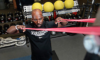 Assistant UVa strength and conditioning coach   Everrett Gathron demonstrates the band face pulls exercise at the McCue Center weight room on campus at the University of Virginia in Charlottesville, VA. Photo/Andrew Shurtleff