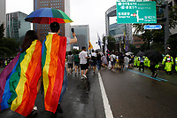 JHK01. Seoul (Korea, Republic Of), 15/07/2017.- Participants hold a rainbow umbrella - a symbol of lesbian, gay, bisexual and transgender and intersex (LGBTI) people as they march during the Korea Queer Culture Festival in Seoul, South Korea, 15 July 2017. The 18th Korea Queer Culture Festival consists of various special events, such as a gay pride parade, a night club party in the central Seoul district of Itaewon and a four-day screening of films on sexual minorities. (Cine, Corea del Sur, Seúl) EFE/EPA/KIM CHUL-SOO