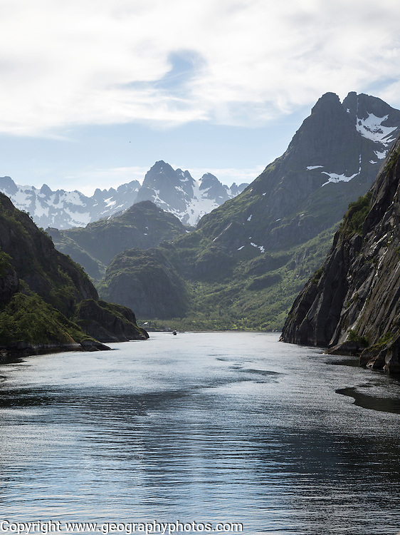Steep sided glacial trough fiord jagged mountain peaks, Trollfjorden, Lofoten Islands, Nordland, northern, Norway