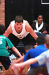 Williamsport basketball sophomore Christopher Kinley, left, helps with the right stance during Little Millionaires basketball practice at the high school Tuesday Oct. 26, 2010.