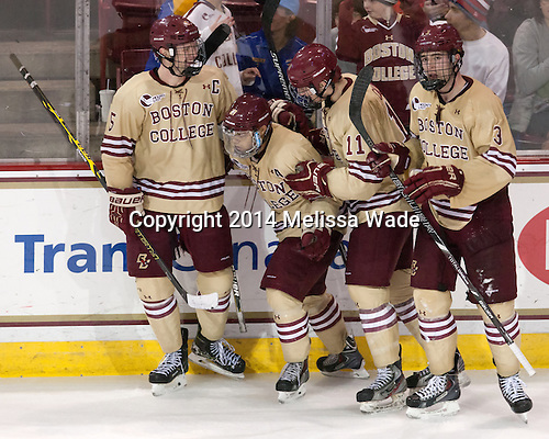 Michael Matheson (BC - 5), Quinn Smith (BC - 27), Chris Calnan (BC - 11), Ian McCoshen (BC - 3) - The Boston College Eagles defeated the visiting University of Michigan Wolverines 5-1 (EN) on Saturday, December 13, 2014, at Kelley Rink in Conte Forum in Chestnut Hill, Massachusetts.