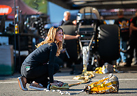 Nov 9, 2018; Pomona, CA, USA; Leeza Diehl packs the parachutes for the car of her husband, NHRA funny car driver Jeff Diehl during qualifying for the Auto Club Finals at Auto Club Raceway. Mandatory Credit: Mark J. Rebilas-USA TODAY Sports