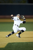Wake Forest Demon Deacons shortstop Patrick Frick (5) catches a pop-up during the game against the North Carolina State Wolfpack at David F. Couch Ballpark on April 18, 2019 in  Winston-Salem, North Carolina. The Demon Deacons defeated the Wolfpack 7-3. (Brian Westerholt/Four Seam Images)