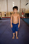 Cambodia peasant boy learns to be acrobat