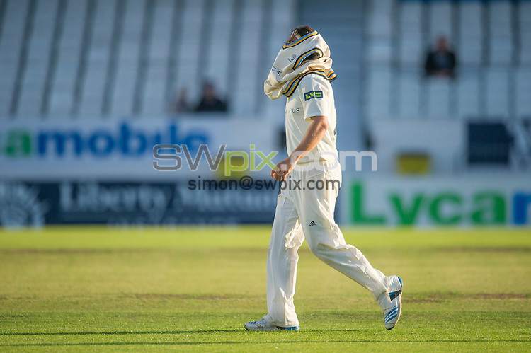 Picture by Allan McKenzie/SWpix.com - 26/09/2014 - Cricket - LV County Championship Div One - Yorkshire County Cricket Club v Somerset County Cricket Club - Headingley Cricket Ground, Leeds, England - Yorkshire's Jack Brooks takes his sweater.