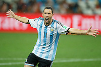 Maxi Rodriguez of Argentina celebrate scoring the winning penalty