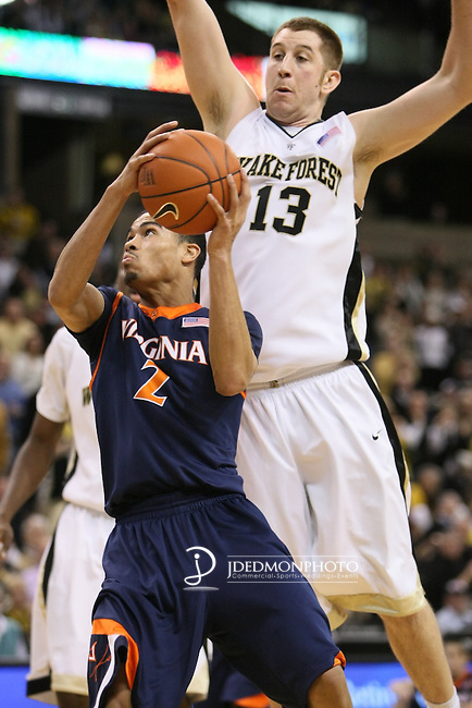 202 23 January 2010: In game action at Joel Coliseum Winston Salem North Carolina as Virginia's guard Mustapha Farrakhan goes for the bucket against Wake Forest center Chas McFarland. Wake would hand the Cavs their first ACC loss 69-57..Mandatory Credit:Jim Dedmon/ Southcreek Global, Virginia 57 at Wake 69
