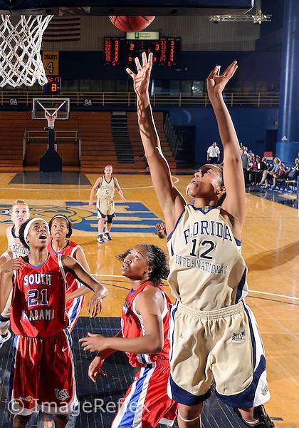 Florida International University women's basketball forward Elisa Carey (12) shoots against the University of South Alabama which won the game 65-47 on December 20, 2008 at Miami, Florida. .