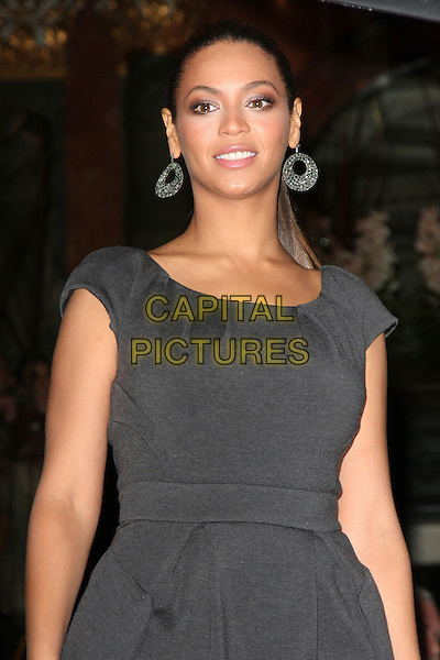 BEYONCE KNOWLES .seen outside the Mandarin Oriental Hotel in Knightsbridge, London, England, November 10th 2008.half length dress  earrings grey gray .CAP/ROS.©Steve Ross/Capital Pictures