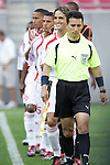 13 March 2008: The Assistant Referee leads the Cuba starting ten onto the field.  After defections and red card suspensions, only ten players were available to play. The Honduras U-23 Men's National Team defeated the Cuba U-23 Men's National Team 2-0 at Raymond James Stadium in Tampa, FL in a Group A game during the 2008 CONCACAF's Men's Olympic Qualifying Tournament.