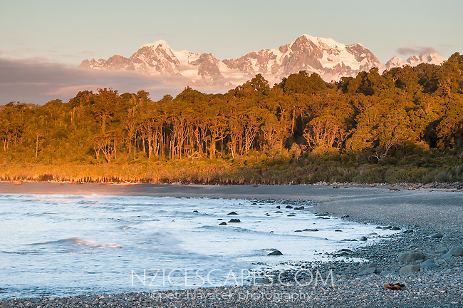 Sunset over Mt. Cook 3754m right and Mt. Tasman 3497m left from Gillespies Beach, Westland NP, West Coast, New Zealand
