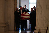 The casket of late Supreme Court Justice John Paul Stevensis carried into the Great Hall of the Supreme Court for a private ceremony in Washington, Monday July 22, 2019.<br /> Credit: Andrew Harnik / Pool via CNP