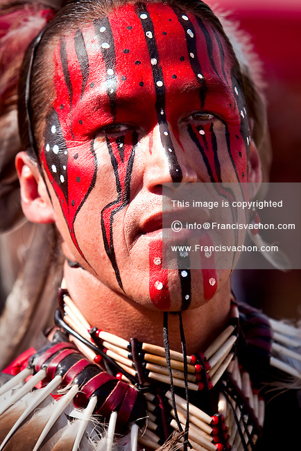 Gerry Hunter, a native of Lac-Simon indian Reservation and wearing Algonquin traditional dresses and paint, takes part into the dance contest of Wendake Pow-Wow July 31, 2010. The Algonquins (also spelled Algonkins) are aboriginal/First Nations inhabitants of North America who speak the Algonquin language, a divergent dialect of the Ojibwe language, which is part of the Algonquian language family.