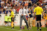New York Red Bulls head coach Mike Petke reacts to a yellow card being given to a player. The New York Red Bulls defeated Real Salt Lake 4-3 during a Major League Soccer (MLS) match at Red Bull Arena in Harrison, NJ, on July 27, 2013.