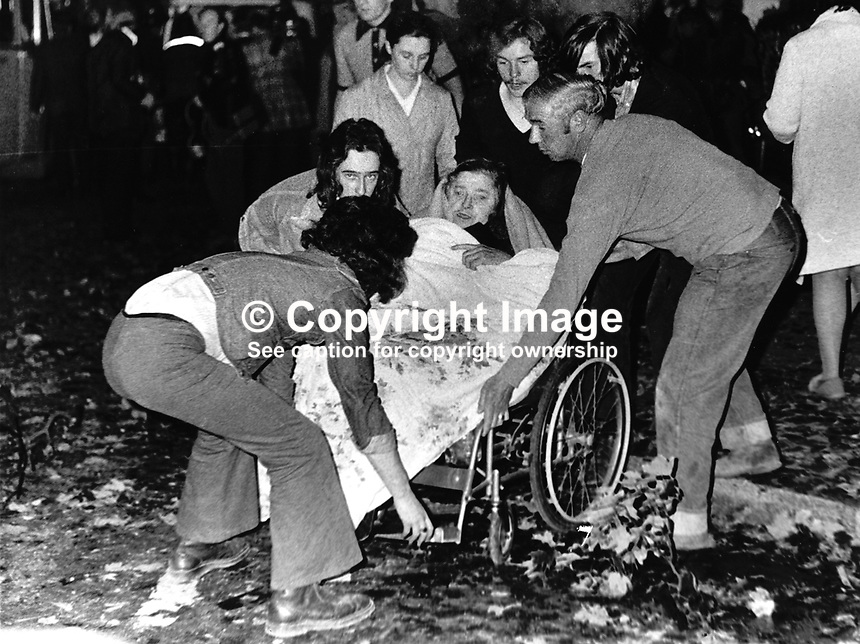 Elderly woman resident of a Salvation Army Old People's Home, suffering from shock following a car bomb explosion, is wheel-chaired away from the scene. The explosion which took place outside the Imperial Hotel, Belfast, N Ireland, killed one man and injured fifty. 15th September 1972. 197209152006.Copyright Image from Victor Patterson, 54 Dorchester Park, Belfast, United Kingdom, UK...For my Terms and Conditions of Use go to http://www.victorpatterson.com/Victor_Patterson/Terms_%26_Conditions.html