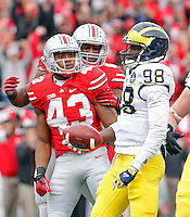 Ohio State Buckeyes linebacker Darron Lee (43) celebrates his sack on Michigan Wolverines quarterback Devin Gardner (98) in the 1st quarter of their game at Ohio Stadium in Columbus, Ohio on November 29, 2014.  (Dispatch photo by Kyle Robertson)