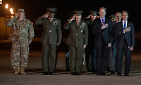 Front row, from left to right: United States Air Force Colonel Matthew Jones, 436th Airlift Wing, Vice Commander; Sergeant Major of the US Marine Corps Ronald Green; US Marine Corps General Robert B. Neller, Commandant of the Marine Corps; Acting United States Secretary of Defense Patrick M. Shanahan; and Governor John Carney (Democrat of Delaware); and US Senator Tom Carper (Democrat of Delaware), salute as a US Marine Corps carry team participates in the Dignified Transfer of the transfer case containing the remains of US Marine Corps Staff Sergeant Christopher A. Slutman at Dover Air Force Base in Dover, Delaware on April 11, 2019.  He died as the result of a road-side bomb in Afghanistan on April 8, 2019.  Staff Sergeant Slutman, a decorated 15 year veteran of the Fire Department of New York (FDNY), was married and had three children. Photo Credit: Ron Sachs/CNP/AdMedia