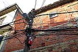 BRAZIL, Rio de Janiero, Favela, a mess of wires on a lamp post in Complexo do Alemao, a neighborhood within the North Zone