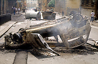 genova luglio 2001, proteste contro il g8. automobile distrutta --- genoa july 2001, protests against g8 summit. destroyed car