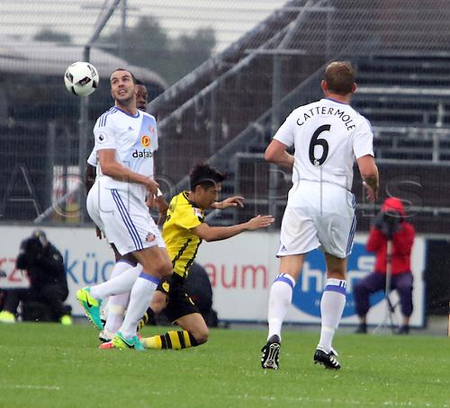 05.08.2016. Caspoint Arena, Altach, Austria.  Pre Season Football Friendly. Borussia Dortmund versus Sunderland.  John O'SHEA (Sunderland) challanges Shinji KAGAWA (Dortmund)