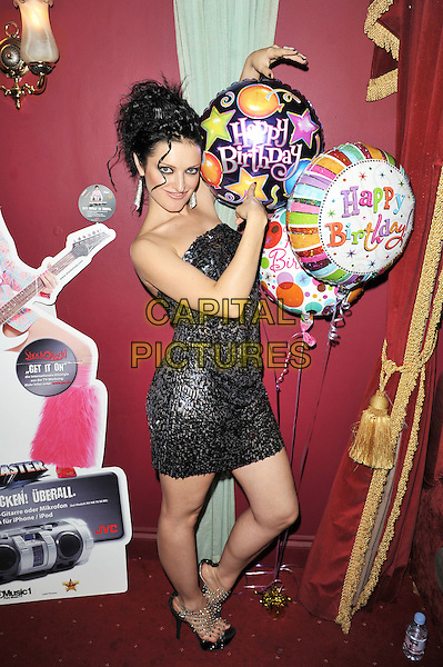 ShockOlady.Performing live at Sophisticats, Central London, England..27th October, 2011.full length black strapless dress sequins sequined side balloons happy birthday .CAP/MAR.© Martin Harris/Capital Pictures.