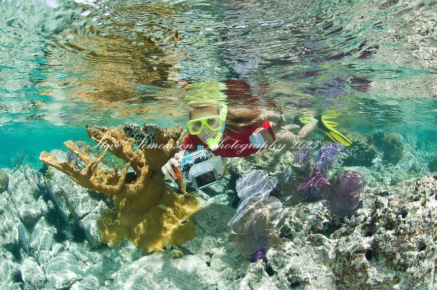 Snorkeler Jen Gibbud with Canon G11<br /> Caneel Bay Beach<br /> Virgin Islands National Park.St. John, U.S. Virgin Islands