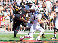 College Park, MD - SEPT 23, 2017: UCF Knights quarterback McKenzie Milton (10) avoids the sack by Maryland Terrapins defensive lineman Mbi Tanyi (50)  during game between Maryland and UCF at Capital One Field at Maryland Stadium in College Park, MD. (Photo by Phil Peters/Media Images International)