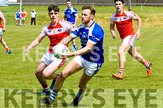 Kerins O'Reilly's Barry John Keane in possession of the ball, closely watched by Daingean Uí Chúis Tomas Leo Ó Súilleabhain during the County Senior Football Championship match at Pairc An Aghasaigh, Dingle, on Sunday afternoon.