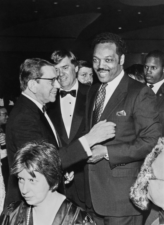 Sen. Paul Simon, D-Ill., and Presidential Candidate Rev. Jesse Jackson with party members in March 1988. (Photo by CQ Roll Call via Getty Images)