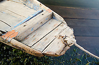 "Close-up view of bow of traditional ""shikara"" row boat on the shore of Dal Lake, Srinagar, Kashmir, India."