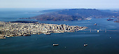 Aerial View of San Francisco, California from a jet ascending after take -off from San Francisco International Airport on Wednesday, February 22, 2012.  The Golden Gate Bridge can be seen at the center in the background..Credit: Ron Sachs / CNP