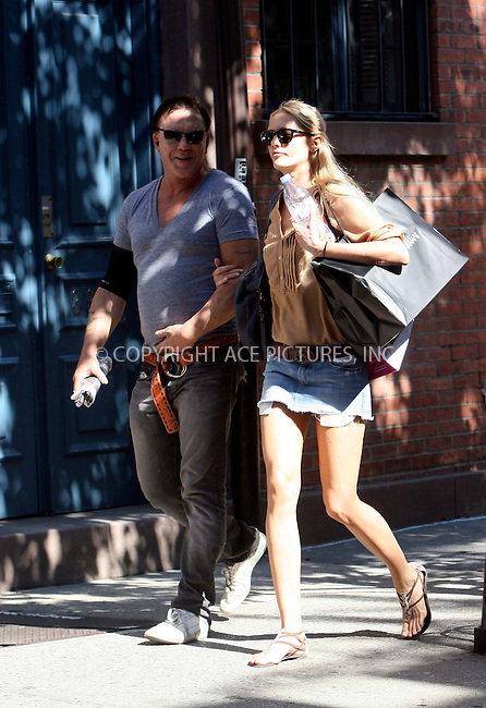 WWW.ACEPIXS.COM . . . . .  ....July 2 2010, New York City....Actor Mickey Rourke and his girlfriend Elena Kuletskaya walking in the Meatpacking Dirtrict on July 2 2010 in New York City....Please byline: NANCY RIVERA- ACEPIXS.COM.... *** ***..Ace Pictures, Inc:  ..Tel: 646 769 0430..e-mail: info@acepixs.com..web: http://www.acepixs.com