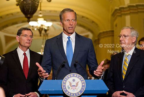 United States Senator John Thune (Republican of South Dakota) speaks to reporters following the Republican Party luncheon in the United States Capitol in Washington, DC on Tuesday, June 27, 2017.  From left to right: US Senator John Barrasso (Republican of Wyoming), Senator Thune and US Senate Majority Leader Mitch McConnell (Republican of Kentucky).<br /> Credit: Ron Sachs / CNP