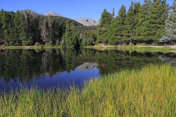 Spaulding Lake with reflection and the Continental Divide in Rocky Mountain National Park, west of Estes Park, Colorado, USA .  John leads private photo tours throughout Colorado. Year-round Colorado photo tours.