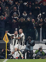 Goal Gonzalo Higuain Calcio, Serie A: Juventus vs Roma. Torino, Juventus Stadium,17 dicembre 2016. <br /> Juventus&rsquo; Gonzalo Higuain, left, celebrates with teammate Stefano Sturaro after scoring the winning goal during the Italian Serie A football match between Juventus and Roma at Turin's Juventus Stadium, 17 December 2016.<br /> UPDATE IMAGES PRESS/Isabella Bonotto