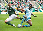 Hibs v St Johnstone...25.08.12   SPL.James McPake blocks Gregory Tade.Picture by Graeme Hart..Copyright Perthshire Picture Agency.Tel: 01738 623350  Mobile: 07990 594431