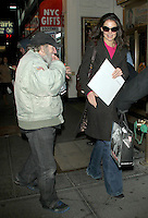 NEW YORK, NY - JANUARY 4: Radio Man hands Katie Holmes a keepsake as she is  arriving to her Broadway play Dead Accounts at the Music Box in New York City. January 4, 2013. Credit: RW/MediaPunch Inc. /NortePhoto