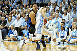 17 February 2016: Duke's Grayson Allen (behind) is fouled by North Carolina's Marcus Paige (5). The University of North Carolina Tar Heels hosted the Duke University Blue Devils at the Dean E. Smith Center in Chapel Hill, North Carolina in a 2015-16 NCAA Division I Men's Basketball game. Duke won the game 74-73.