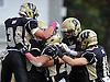 Wantagh No. 34 Kyle Sliwak, left, and teammates celebrate after a touchdown in the first quarter of a Nassau County Conference II varsity fiootball game against Garden City at Wantagh High School on Saturday, October 24, 2015. Garden City won by a score of 28-18.<br /> <br /> James Escher