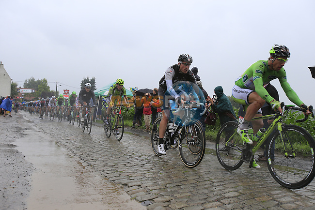 Riders including Peter Sagan (SVK) Cannondale tackle the1st cobbled sector 9 from Gruson to Crossroads de l'Arbe during Stage 5 of the 2014 Tour de France running 155.5km from Ypres to Arenberg. 9th July 2014.<br /> Picture: Eoin Clarke www.newsfile.ie