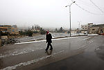Palestinians walk on on a street during a snow storm near the Ibrahimi mosque in the Old city of the West Bank city of Hebron, on January 17, 2019. Photo by Wisam Hashlamoun