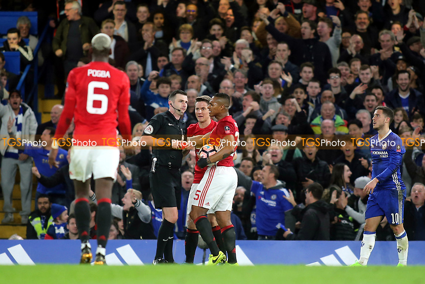 Manchester United's Antonio Valencia reacts after Ander Herrera was shown a red card by referee, Michael Oliver during Chelsea vs Manchester United, Emirates FA Cup Football at Stamford Bridge on 13th March 2017