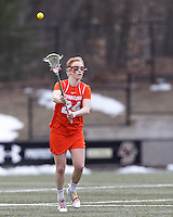 Syracuse University midfielder Bridget Daley (24) passes the ball.   Syracuse University (orange) defeated Boston College (white), 17-12, on the Newton Campus Lacrosse Field at Boston College, on March 27, 2013.